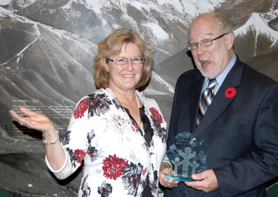 Parks director Anne Charleton and Belline president Rob Taylor celebrate the award. [photo by Michelle Reid]