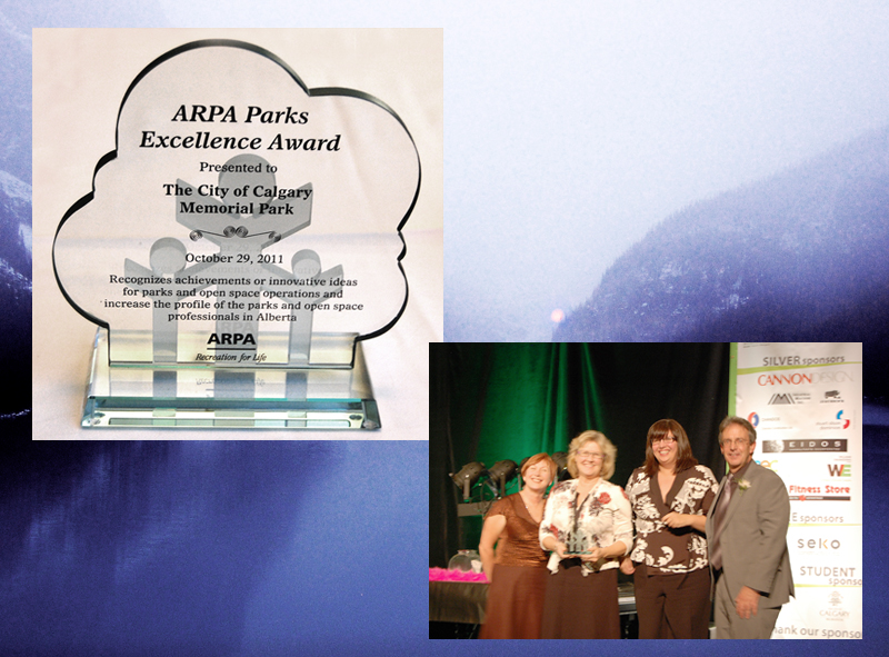 Calgary parks director Anne Charlton and CMP project manager Michelle Reid accept the ARPA parks excellence award from CFO Seve Allan.  [photo by Beltline]