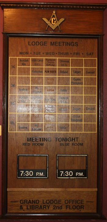 The board that informs of lodge meetings in the building